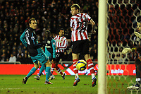 Football - FA Cup Fifth Round - Sunderland vs. Arsenal<br /> Kieran Richardson (Sunderland) shoots through a crowed goal area and scores at the Stadium of Light.