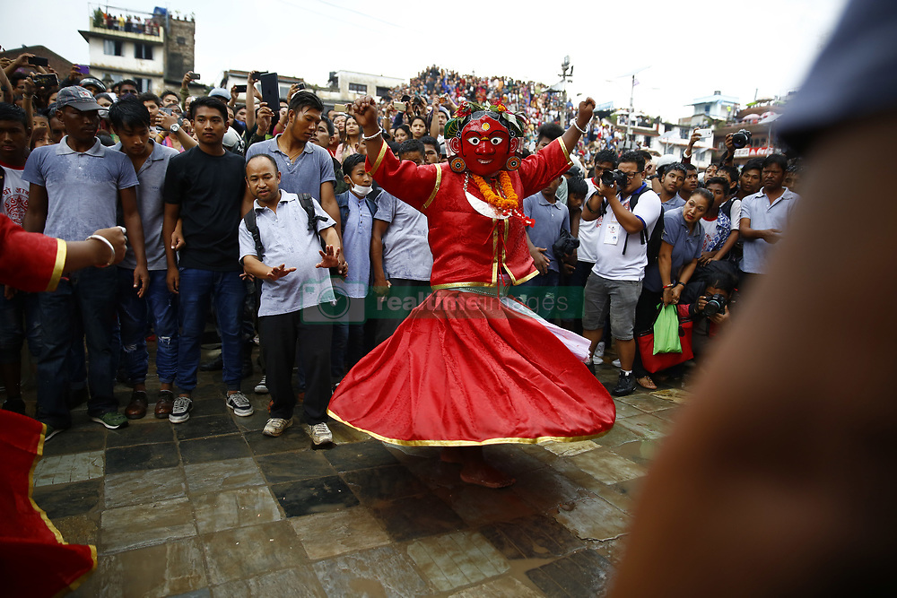 September 5, 2017 - Kathmandu, Nepal - People dressed as Deities perform during Indrajatra festival, celebrated to honor Indra, the King of Heaven and Lord of Rains in Kathmandu on Tuesday, September 5, 2017. Indra Jatra is the biggest religious street festival held annually in Nepal celebrated by singing, mask dancing, rejoicing and devotees offering prayers along with other rituals hold the eight-day festival celebrated by both Hindus and Buddhists. (Credit Image: © Skanda Gautam via ZUMA Wire)