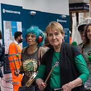 """2021-09-09 Euston, London, UK. Environmental activists protests of HS2 line as they urge the Government to """"pull the emergency brakes"""" on the project assembly at St Pancras New Church march to Euston Station."""