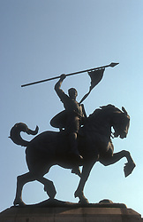 Statue of 'El Campeador' in Seville depicting man riding horse and waving spear,