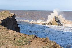 Waves pounding the Godwin Coast Artillery Battery; wartime defence at Kilnsea; East Yorkshire; England,