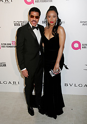 Lionel Richie and  Lisa Parigi arriving at the Elton John Oscar Party held in Beverly Hills, Los Angeles, USA.