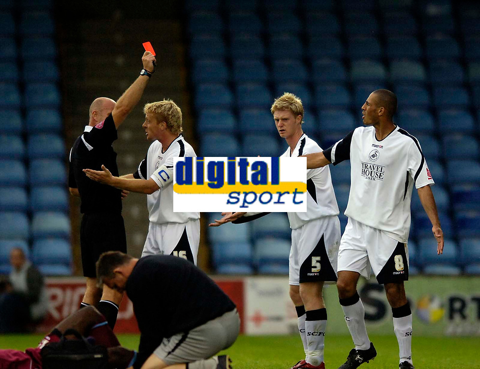 Photo: Jed Wee.<br /> Scunthorpe United v Swansea City. Coca Cola League 1. 08/08/2006.<br /> <br /> Swansea's Alan Tate (5) protests his innocence after being shown the red card for a clumsy challenge on Scunthorpe's Cleveland Taylor.