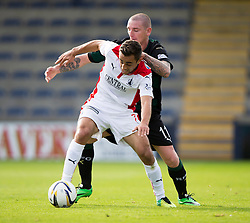 Falkirk's Tom Taiwo and Raith Rovers Martin Scott.<br /> half time : Raith Rovers 0 v 0 Falkirk, Scottish Championship game played 27/9/2014 at Raith Rovers Stark Park.