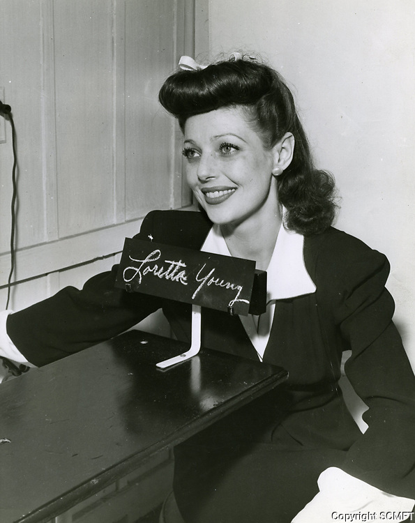 10/43 Loretta Young having her picture taken and being fingerprinted (for her ID card) so she could volunteer at the Hollywood Canteen