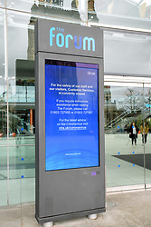 Coronavirus warning information at entrance to The Forum, Norwich UK March 2020