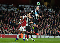 Football - 2018 / 2019 Premier League - Arsenal vs. Newcastle United<br /> <br /> Paul Dummett (Newcastle United)  leaps high to defend the cross at The Emirates.<br /> <br /> COLORSPORT/DANIEL BEARHAM