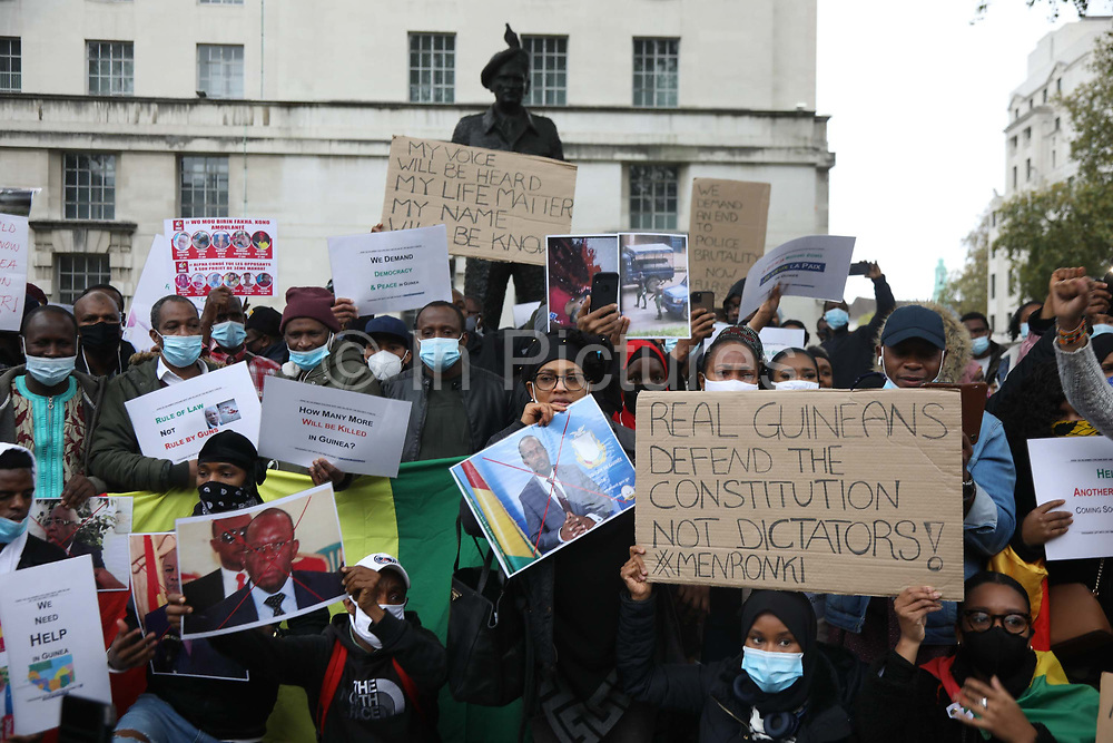 Activists calling for an end to human rights abuses in Guinea in Whitehall 24th of October 2020, London, United Kingdom. Protester opposite Downing Street 10 call for and end to alleged human rights abuses and killings by the ruling government in Guinea.
