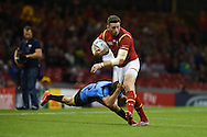 Alex Cuthbert of Wales is tackled by Gaston Mieres of Uruguay. Rugby World Cup 2015 pool A match, Wales v Uruguay at the Millennium Stadium in Cardiff, South Wales  on Sunday 20th September 2015.<br /> pic by  Andrew Orchard, Andrew Orchard sports photography.