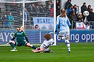 Manchester City Women goalkeeper Ellie Roebuck (26) saves West Ham United Women forward Leanne Kiernan (8) shot on goal during the FA Women's Super League match between Manchester City Women and West Ham United Women at the Sport City Academy Stadium, Manchester, United Kingdom on 17 November 2019.