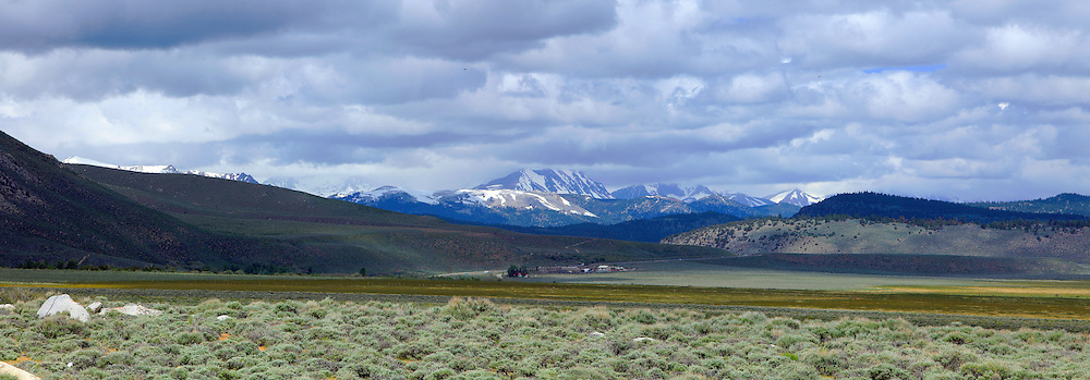 A Sierra ranch and vista captured in a panorama from the roadside.