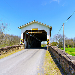 Goodville, PA / USA - April 28 2020: Weaver's Mill Covered Bridge spans the Conestoga River in eastern Lancaster County, PA.