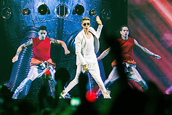 "© Licensed to London News Pictures . 21/02/2013 . Manchester , UK . Canadian pop star JUSTIN BIEBER performs on stage at the Manchester Arena in England on the opening night of his UK "" Believe "" tour . Photo credit : Joel Goodman/LNP"