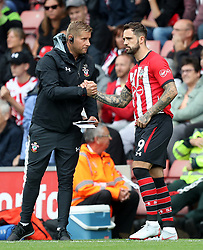 """Southampton's Danny Ings shakes hands with goalkeeping coach Dave Watson before entering the game during the Premier League match at St Mary's, Southampton. PRESS ASSOCIATION Photo. Picture date: Sunday August 12, 2018. See PA story SOCCER Southampton. Photo credit should read: Andrew Matthews/PA Wire. RESTRICTIONS: EDITORIAL USE ONLY No use with unauthorised audio, video, data, fixture lists, club/league logos or """"live"""" services. Online in-match use limited to 120 images, no video emulation. No use in betting, games or single club/league/player publications."""