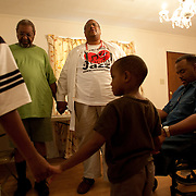 GREENVILLE, MS - September 3, 2005:  Dr. Ronald Myers, dealing with the Hurricane Katrina crisis professionally and personally, prays with evacuees while on his rounds.