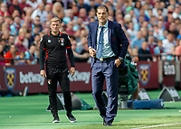 Football - 2016 / 2017 Premier League - West Ham United vs. AFC Bournemouth<br /> <br /> West Ham Manager Slaven Bilic and Bournemouth Manager Eddie Howe wtach the action from the touch line  at The London Stadium.<br /> <br /> COLORSPORT/DANIEL BEARHAM
