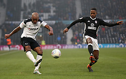 Derby County's Andre Wisdom and Fulham's Ryan Sessengnon battle for the ball during the match at Pride Park Stadium