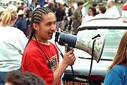Parade coordinator age 18 with bullhorn at Cinco de Mayo.  St Paul Minnesota USA