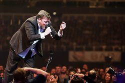 © Licensed to London News Pictures. 02/12/2012. London, UK.   Guy Garvey of Elbow performing live at The O2 Arena. Elbow are an English alternative rock band, comprising Guy Garvey (vocals, guitar), Richard Jupp (drums, percussion), Craig Potter (keyboards, piano), Mark Potter (guitar, backing vocals), and Pete Turner (bass guitar, backing vocals). They have played together since 1990 and released five studio albums: Asleep in the Back (2001), Cast of Thousands (2003), Leaders of the Free World (2005), The Seldom Seen Kid (2008) and Build a Rocket Boys (2011).   Photo credit : Richard Isaac/LNP