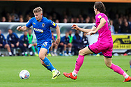 AFC Wimbledon midfielder Max Sanders (23) taking on Rochadale defender Jordan Williams (8) during the EFL Sky Bet League 1 match between AFC Wimbledon and Rochdale at the Cherry Red Records Stadium, Kingston, England on 5 October 2019.