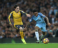 Hector Bellerin of Arsenal tussles with Raheem Sterling of Manchester City during the English Premier League match at the Etihad Stadium, Manchester. Picture date: December 18th, 2016. Picture credit should read: Simon Bellis/Sportimage