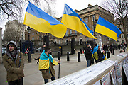 London, UK. Tuesday 4th March 2014. Ukrainian protesters demonstrate outside Downing Street asking for the UK government, NATO and other organisations to help them protect their autonomy against Russia, and to remain a soverign nation.