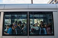 A group of passengers sits in a tram car on Jaffa St. Jerusalem has a good light rail system.