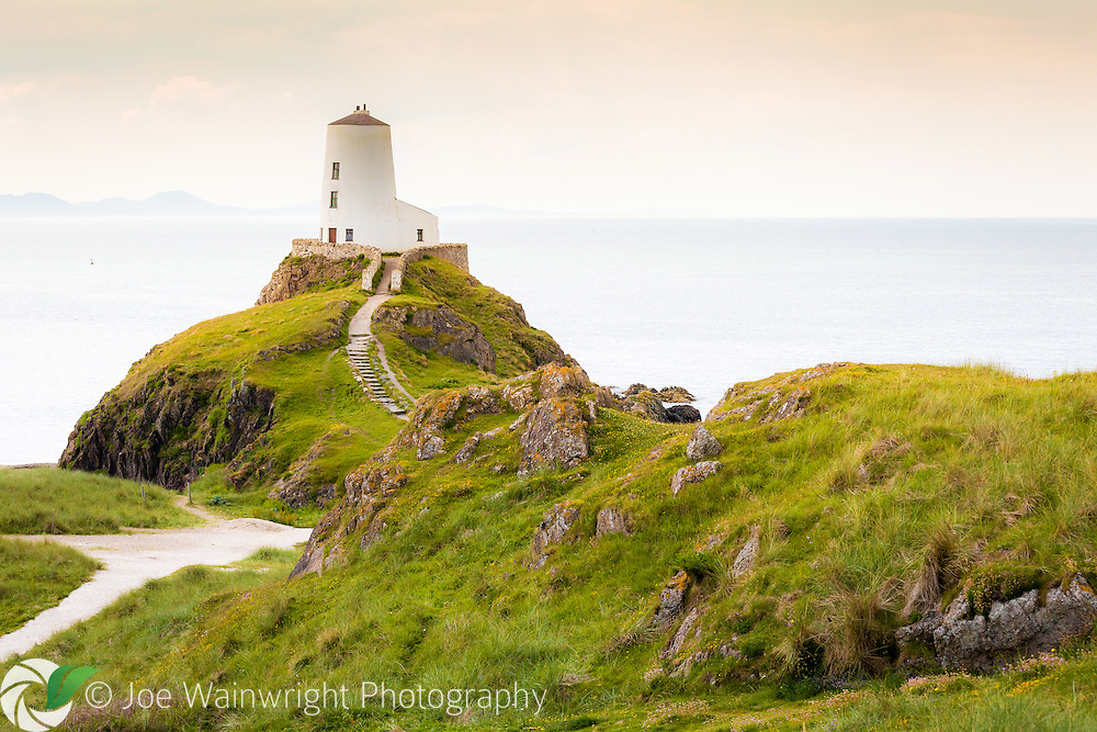 Llanddwyn Island is part of the National Nature Reserve of Newborough Warren.  The island is associated with Dwynwen, the Welsh patron saint of lovers.  The lighthouse marks the western entrance to the Menai Straits.