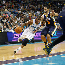 December 17, 2010; New Orleans, LA, USA; New Orleans Hornets point guard Chris Paul (3) drives past Utah Jazz point guard Deron Williams (8) during the second half at the New Orleans Arena.  The Hornets defeated the Jazz 100-71. Mandatory Credit: Derick E. Hingle