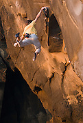 """Kevin Jorgeson soloing """"Stony White Boots Johnson"""" 5.13b, at Salt Point, Sonoma Coast, California, during the filming of Chuck Fryburger's film PURE."""