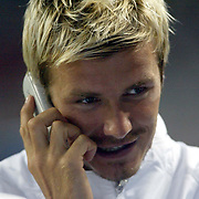 Manchester United's David Beckham on the phone