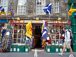 Exterior of tourist shop with Scottish flags on Royal Mile in Edinburgh Scotland