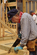 Former President Jimmy Carter working at a Habitat for Humanity project near Washington DC in June 1992..Photograph by Dennis Brack bb30
