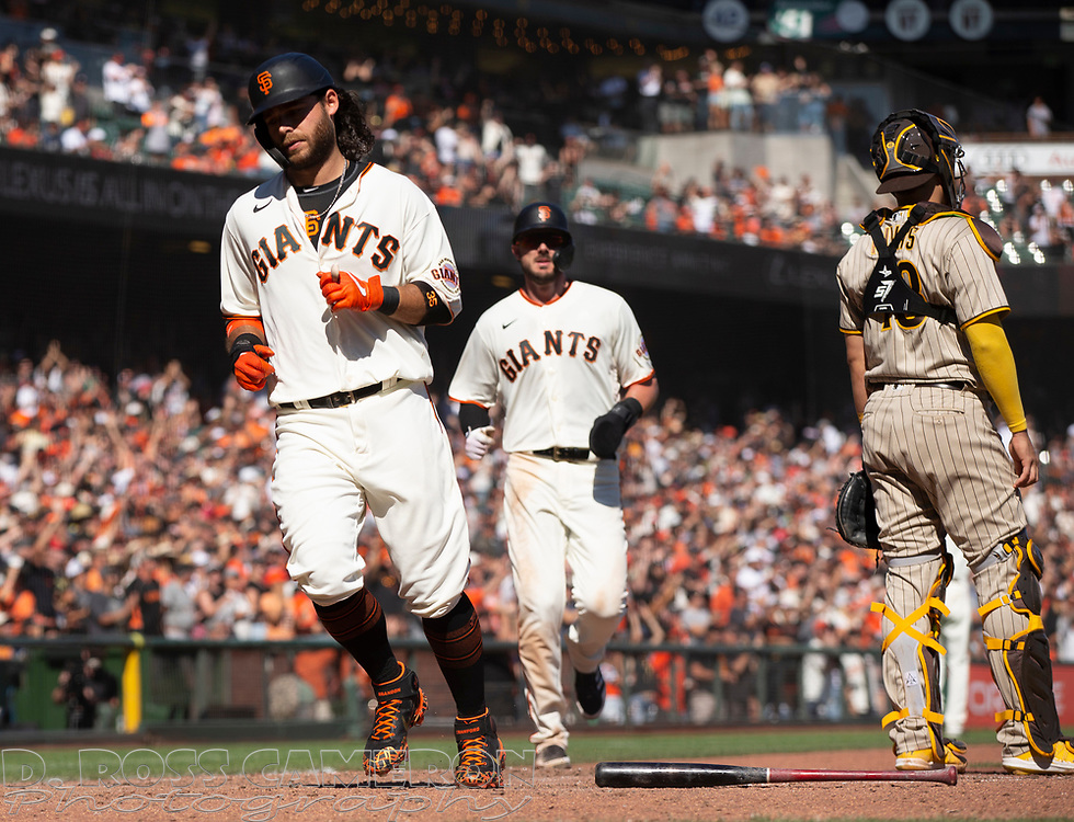 Oct 3, 2021; San Francisco, California, USA; San Francisco Giants shortstop Brandon Crawford (35) and left fielder Kris Bryant (23) score close to together on a double by Mike Yastrzemski during the seventh inning against the San Diego Padres at Oracle Park. Mandatory Credit: D. Ross Cameron-USA TODAY Sports