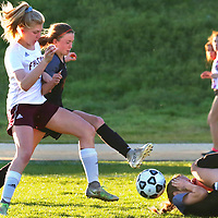 Scotts Valley High's Sydney Ginieczki , left, battles Santa Cruz High's Summer Laskey for control of the ball as Laskey's teammate Lauren Banks takes a protective position after loosing her footing during the teams' 2-2 tie.<br /> Photo by Shmuel Thaler <br /> shmuel_thaler@yahoo.com www.shmuelthaler.com