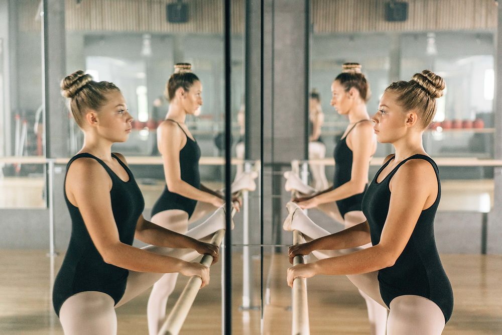 Two ballerinas preparing