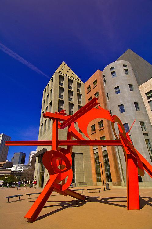 "Sculpture ""Lao Tzu"" by Mark di Suvero (Denver Art Museum) with the Denver Central Library behind, Acoma Plaza, Civic Center Cultural Complex, Denver, Colorado, USA"