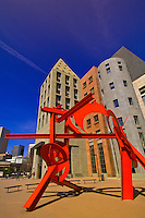 "Sculpture ""Lao Tzu"" by Mark di Suvero (Denver Art Museum) with the Denver Central Library behind, Acoma Plaza, Civic Center Cultural Complex, Denver, Colorado, USA"