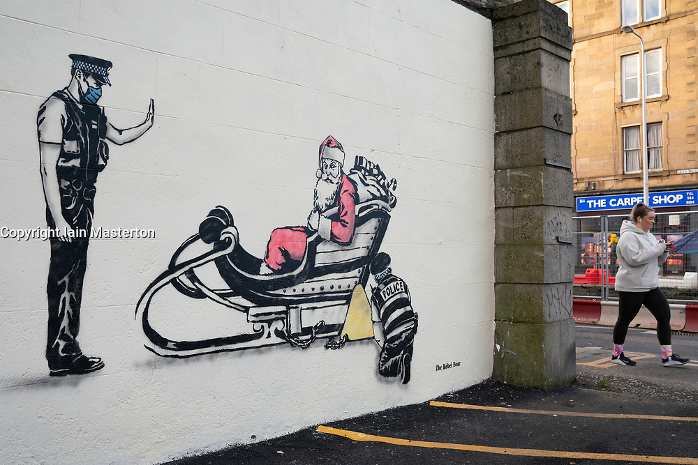 Edinburgh, Scotland, UK. 24 December 2020. New street art by The Rebel Bear has appeared on a wall on Leith Walk in Edinburgh. The Covid-19 lockdown and Christmas themed mural is the latest by the artist to be found in the area. Iain Masterton/Alamy Live News.