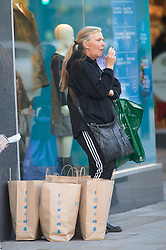 © Licensed to London News Pictures. 04/11/2020.  <br /> Bromley, UK. Shopping done now time for a cigarette. Last minute lockdown panic buying shoppers flock to Bromley High Street in South London this afternoon to get food essentials and Christmas gifts. Photo credit:Grant Falvey/LNP