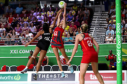 England's Helen Housby (GA) and New Zealand's Temalisi Fakahokotau in action in the netball at the Gold Coast Convention and Exhibition Centre during day seven of the 2018 Commonwealth Games in the Gold Coast, Australia.