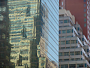 Reflection of office and residential high rise in a huge glass high rise building.