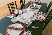 Celebrating Christmas and Hannukah. Decorated Christmas dinner table with a Hannukah Menorah