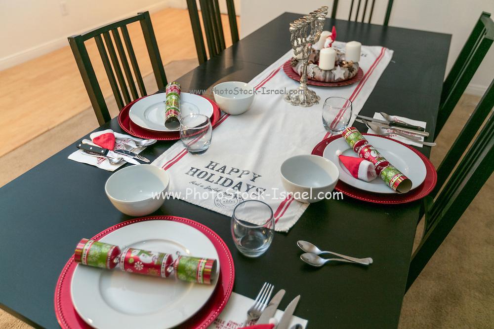 Celebrating Christmas and Hannukah. Decorated Christmas dinner table with a Hannukah Menorah