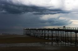 © Licensed to London News Pictures. <br /> 08/06/2014. <br /> <br /> Saltburn, United Kingdom<br /> <br /> Dark and brooding thunder clouds form over Saltburn, Cleveland.<br /> <br /> Photo credit : Ian Forsyth/LNP