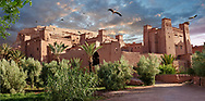 Towering Delusions - Adobe buildings of the Berber Ksar or fortified village of Ait Benhaddou with storks circling and nesting at sunset, Sous-Massa-Dra Morocco. By photographer Paul E Williams.<br /> <br /> Visit our LANDSCAPE PHOTO ART PRINT COLLECTIONS for more wall art photos to browse https://funkystock.photoshelter.com/gallery-collection/Places-Landscape-Photo-art-Prints-by-Photographer-Paul-Williams/C00001WetsxVxNTo
