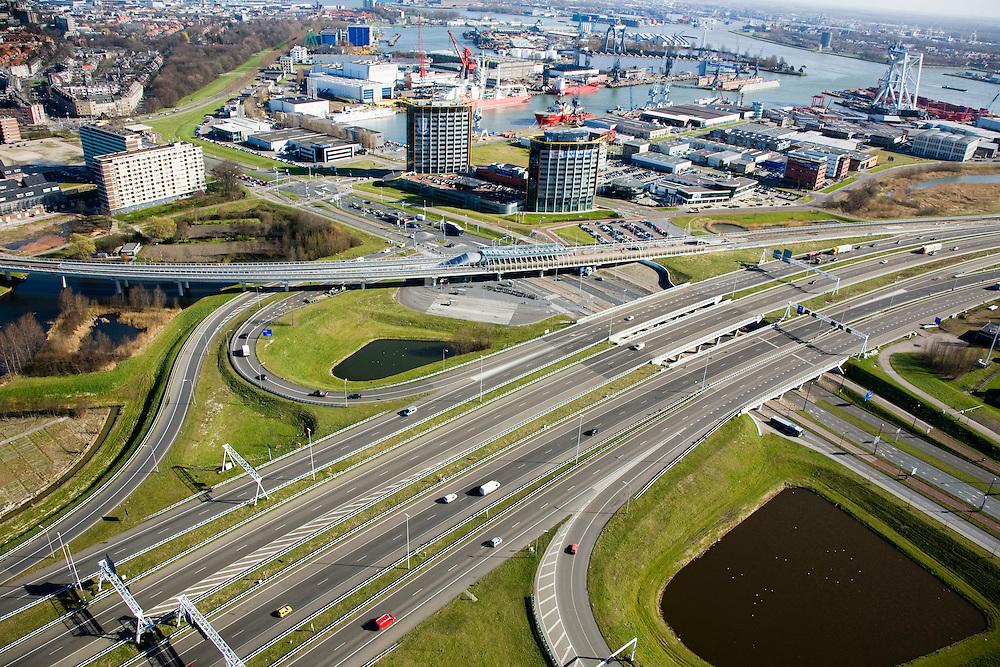 Nederland, Zuid-Holland, Schiedam, 04-03-2008; autosnelweg A4 met op- en afritten, valk voor de Beneluxtunnel; zicht op het bedrijventerrein Vijhuizen, nieuwe ontwikkeling op  het terrein van de voormalige werf Wilton-Fijenoord; het metrostation Vijhuizen, op de grens met Vlaardingen, ligt aan de Calandlijn. .luchtfoto (toeslag); aerial photo (additional fee required); .foto Siebe Swart / photo Siebe Swart
