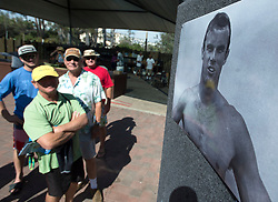October 13, 2016 - Dana Point, California, USA - Friends of Robert Nealy look over old pictures before the start of a memorial service at Dohney State Beach in Dana Point, California, October 13, 2016...Friends and family gathered for a memorial for Nearly who is credited with inventing the Velco surf leach in 1973...Nealy lost a long battle with lymphoma on September 1, 2016...(Photo by Jeff Gritchen, Orange County Register/SCNG) (Credit Image: © Jeff Gritchen/The Orange County Register via ZUMA Wire)