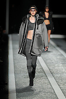 A model walks the runway wearing Alexander Wang for H&M in New York on October 16th, 2014