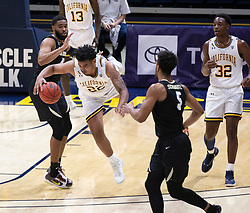 Feb 13, 2021; Berkeley, California, USA; California Golden Bears forward Andre Kelly (22) leaves his feet as he steals the ball from Colorado Buffaloes forward Jeriah Horne (41) during the first half of an NCAA basketball game at Haas Pavilion. Mandatory Credit: D. Ross Cameron-USA TODAY Sports
